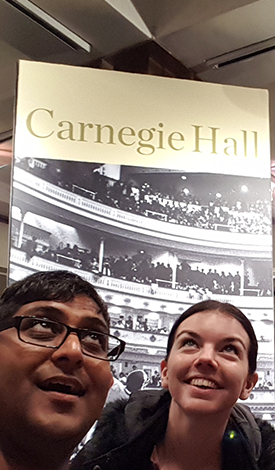 BRYO members looking at Carnegie Hall banner
